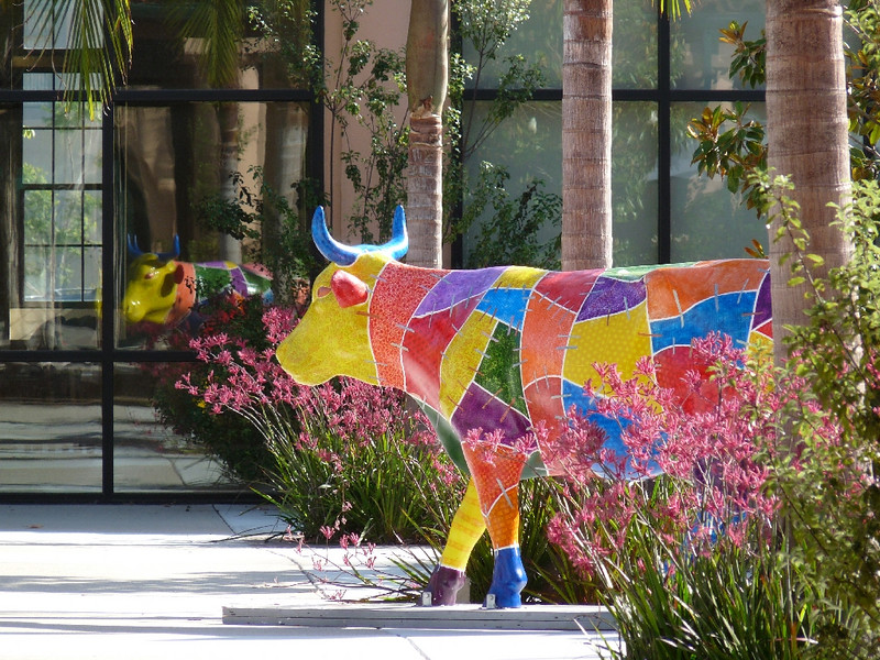 "I like the reflection of this ""Crazy Quilt Cow"" in the glass"
