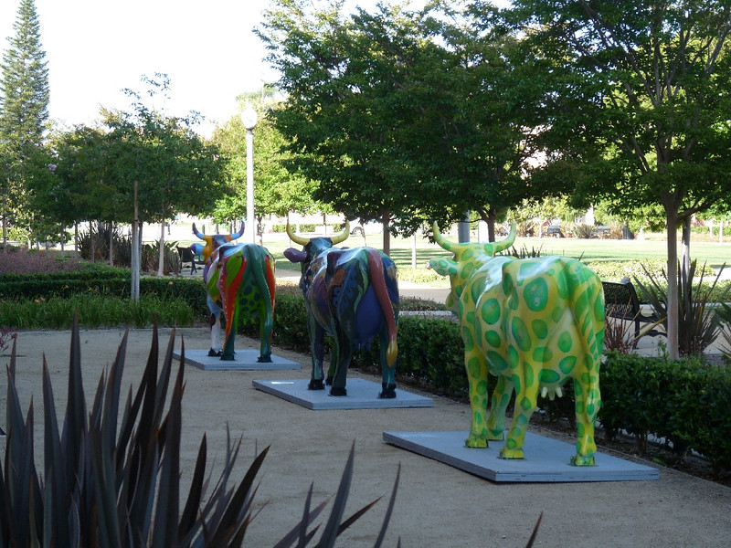 """should they each have the one in front's tail in her mouth, like elephants?<br /> <br /> In case you didn't guess, that last one is called """"Psychedelic Green Cow""""."""