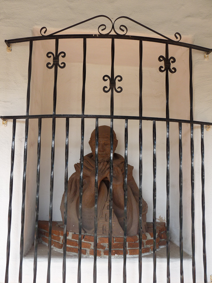 Saints behind bars, it asks more questions than it answers<br /> <br /> Didacus, or Diego, was born in 1400 in San Nicolas del Puerto, in the diocese of Seville in the Spanish Province of Andalusia.<br /> <br /> After Didacus' 1463 death in Alcala, King Phillip II of Spain solicited his canonization, which was decreed in 1588 for the many miracles attributed to him.<br /> <br /> Alcala, Spain, has been the seat of a university and learning center for centuries.  For this reason, the University of San Diego, the Catholic University of the West, is located in a area known as Alcala Park.
