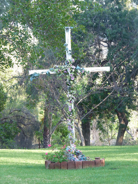 a lovely flower-covered cross in a private area of the Mission
