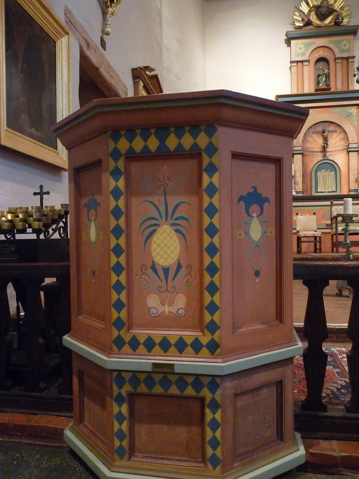 inside the Church, the pulpit with lovely old paint  (remember, the pineapple is the princess of fruits and long a symbol of hospitality)