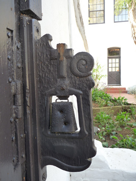 an interesting bell mounted on the inside of the gate in the garden<br /> <br /> The Mission steadily grew from the rebuilding, the land area increasing to 55,000 acres.  Vineyards, orchards and vegetable gardens began to thrive and wheat, barley, corn and beans were harvested.