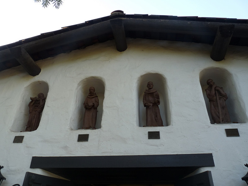 these figures in niches above the Chapel doorway look pretty good from afar, but on close inspection they are really crudely fashioned from rough sheets of clay and not at all attractive to my eye