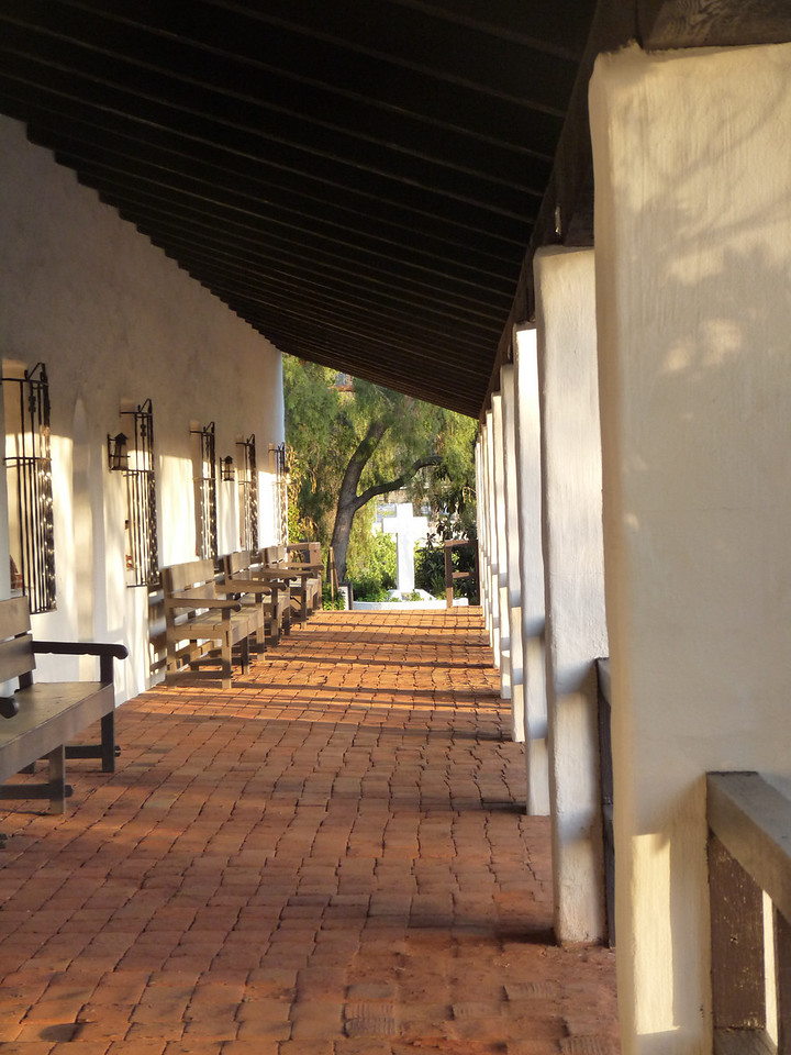 a last look down the covered portico in front of the Mission, with a wonderful play of light