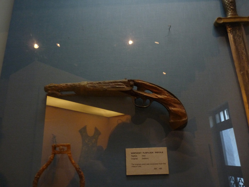 very old flinklock pistol uncovered in the excavation, the wood nearly gone