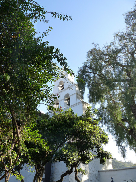 click on this one and make it extra large -- it's a nice shot through the trees<br /> <br /> During an 1813 construction to enlarge the church, buttress wings were added to give earthquake stability to the facade and to provide a more welcoming appearance.