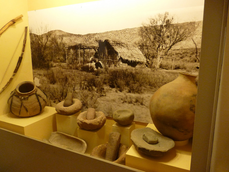 a display in the museum of Kumeyaay pottery and grinding stones