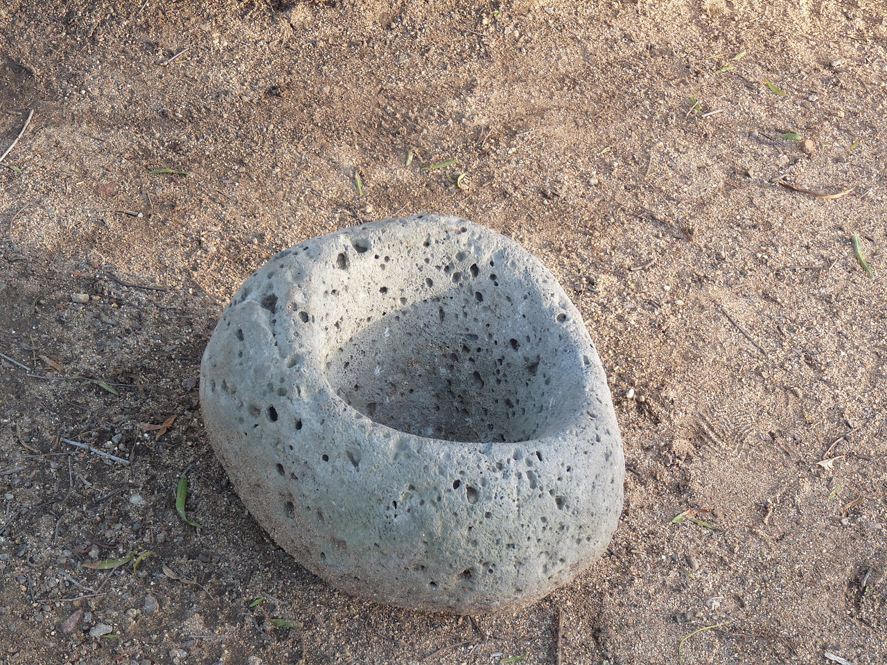 Ewaa-Kumeyaay grinding stone in the yard of the outside display