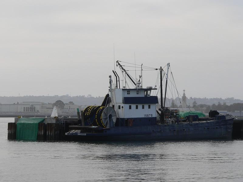 green tarps on a fishing boat
