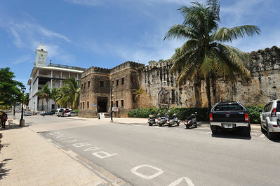 A view of the Olde Fort, built by the Arabs from materials forming a church constructed by the Portugese and extended by the Arabs. The white building in the background is the House of Wonders, Stone Town Zanzibar built by the Arabs as a place of governance.  Today Stone Town is a UNESCO World Hertiage Site.