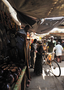 Susan shopping for a Khanga (woman's light cotton wrap) in The Market in Stone Town, Zanzibar