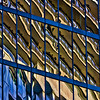 High Rise Bounce – Another abstraction as one high rise is reflected in an adjacent high rise taken in downtown Vancouver near the Sails. Repeating patterns anchored by strong lines anchor the contrast of cool and warm colours.