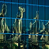 Vancouver Sails – This reflection of the Five Sails at Canada Place uses the glass panes of the adjacent Vancouver Convention Centre to provide an abstract presentation.