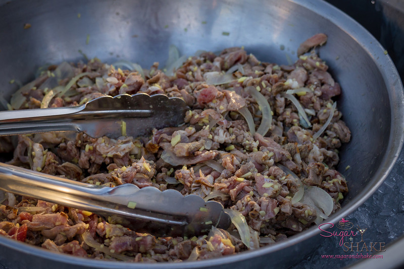 "Hawai'i Food & Wine Festival 2013; Taste our Love for the Land event: Chef Sheldon Simeon (""Top Chef"") — Big Island Goat Kilawen. Local producer: Hawai'i Island Ranchers. © 2013 Sugar + Shake"