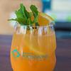 "Hawai'i Food & Wine Festival 2014:  ""Corks & Forks."" ""The Happy Mario"" by Tony Abou-Ganim. Absolut Mandarin vodka, Aperol Apertivo, mango purée, fresh Meyer lemon juice, hibiscus honey lemon, tropical green tea syrup, Moet & Chandon Brut.  © 2014 Sugar + Shake"