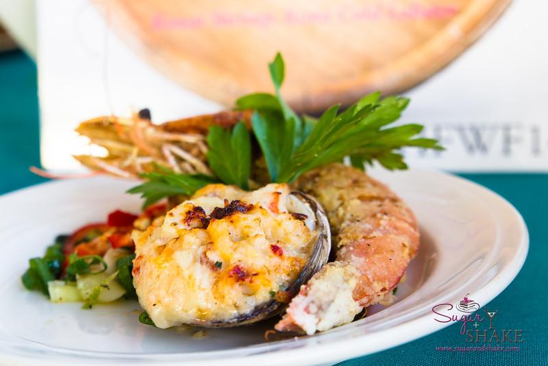 "Hawai'i Food & Wine Festival 2014:  ""Corks & Forks."" Baked Stuffed Cherry Stone Clams with Kona Lobster, Kauai Prawns, Scallop & Crab Meat by Chef Chai Chaowasaree (Chef Chai, Honolulu).  © 2014 Sugar + Shake"