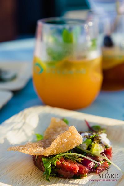 "Hawai'i Food & Wine Festival 2014:  ""Corks & Forks."" Torched Steak Tartare with warm horse radish & sea asparagus by Chef Johan Svensson (BLT Steak, Honolulu).  © 2014 Sugar + Shake"