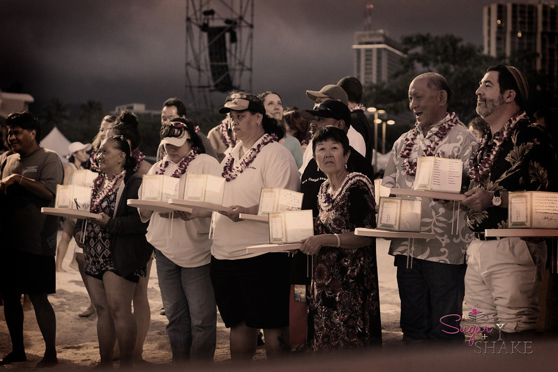 Lanterns are available for the public, on a first-come-first-served basis, with no charge. At the conclusion of the ceremony, everyone floats their lanterns from the beach as the parent lanterns are set into the water by the priests. © 2012 Sugar + Shake