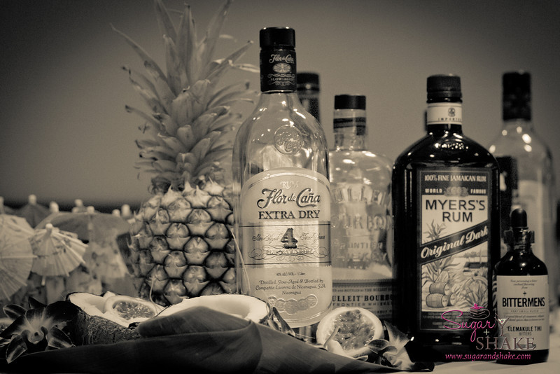 Ingredients for Julie Reiner's modern tropical drink, The Tree House: Bulleit bourbon, Myers's dark rum, macadamia nut orgeat and mole bitters. © 2012 Sugar + Shake