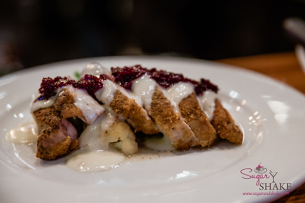 New Summer 2016 Menu Tasting at Pint + Jigger. The Roasted Pork Tenderloin comes served on a bed of roasted cauliflower and haricot vert, topped with cauliflower gravy and port cherries. © 2016 Sugar + Shake