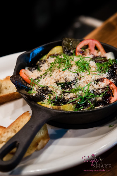 New Summer 2016 Menu Tasting at Pint + Jigger. Summer Skillet, featuring summer vegetables baked in a cast-iron skillet under a topping of mozarella cheese and panko. © 2016 Sugar + Shake