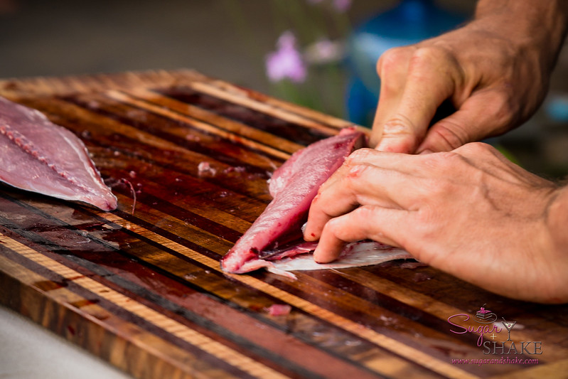 Cutting freshly caught fish on a handmade cutting board. One of the Ala Kukui board members is a master woodworker who teaches local students. © 2017 Sugar + Shake