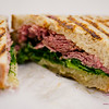 """Where Reuben All My Life (house made pastrami on sour rye; Euphoria cheese, kale slaw, mustard vin, """"(not) Russian"""" aioli). The Market by Capische. © 2014 Sugar + Shake"""