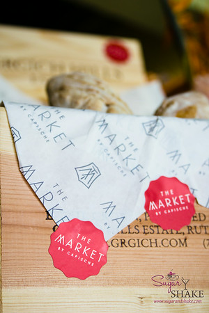 Box of fresh bread. The Market by Capische. © 2014 Sugar + Shake
