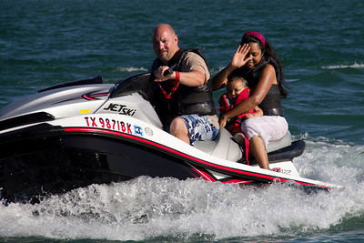 Jessica and Gracie getting a ride on the Jet Ski