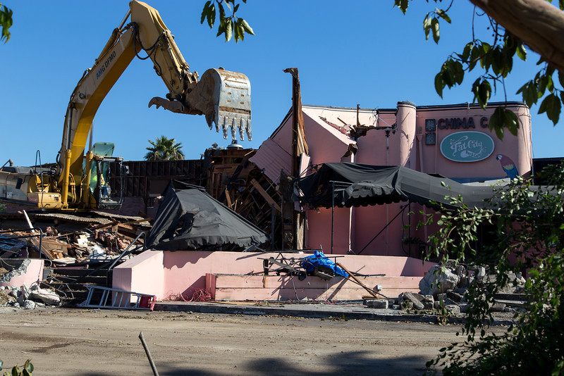 A CAT excavator makes swift work of Fat City.
