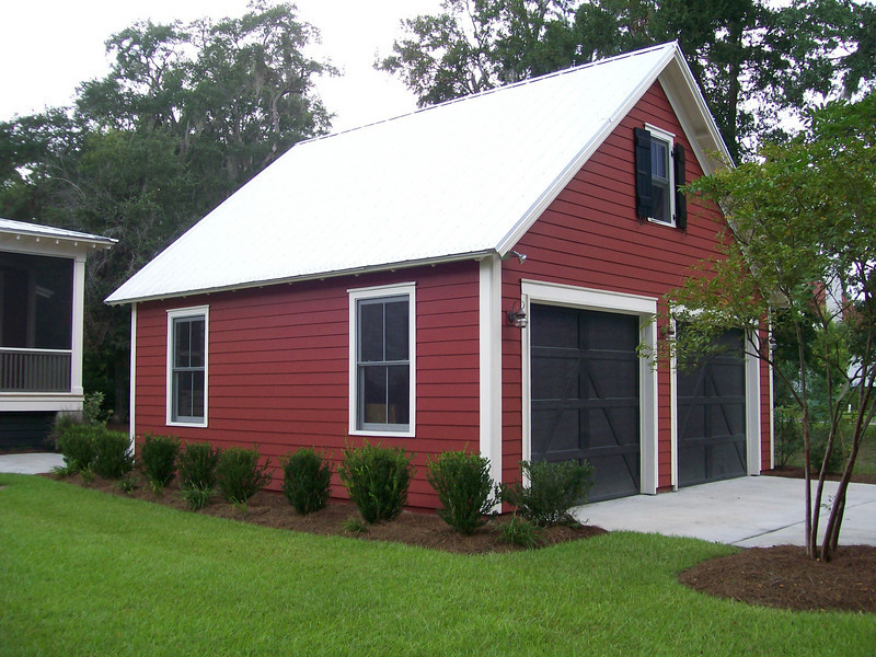 """G0012 built at Coosaw Point in Beaufort, South Carolina. The overall dimensions are 24'-0"""" x 22'-0"""" with 528 Heated Square Feet above. Outbuildings, page 74."""