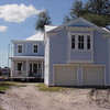 """G0044 by Allison Ramsey Architects built at Hammond's Ferry in North Augusta, South Carolina. This plan is a 2-car garage with bonus space above. The overall dimensions are 24'-0"""" x 26'-0"""" with 624 heated square feet.  Outbuildings, page 69."""