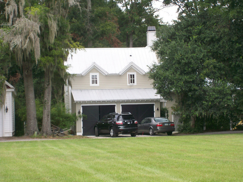 "G0001 is 24'-8"" x 24'-8"" with 328 Heated Square Feet above built at Coosaw Point in Beaufort, South Carolina. Outbuildings, page 89."