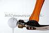 hammer hitting golf ball on tee on white background