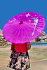 Girl Holding Pink Umbrella