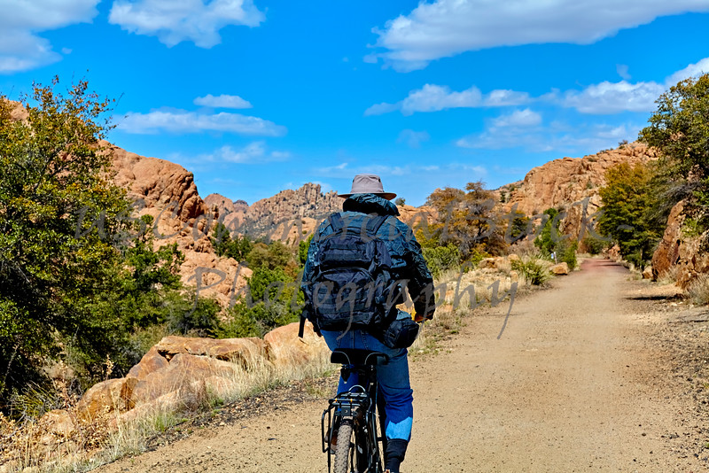 Lone Bike Rider on Mountain Trail
