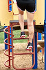 Legs of a Girl climbing a ladder on a playground