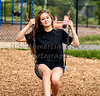 Girl swinging on Swing