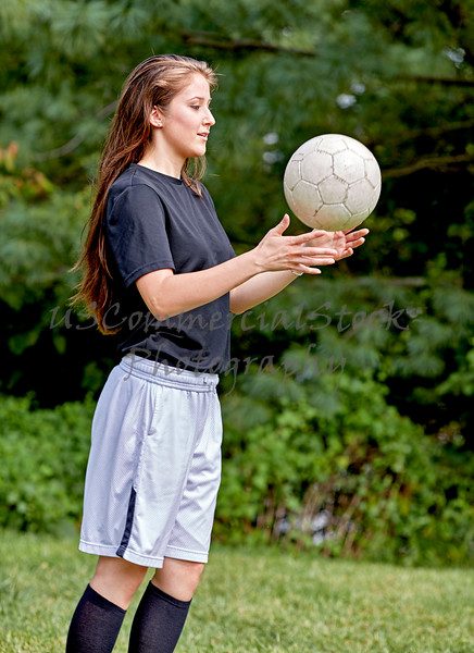 Girl tossing a Soccer Ball