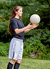 Girl tossing a Soccer Ball