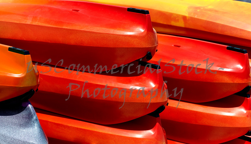 Stacks of Canoes on Dock