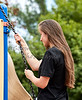 Young Woman holding Chain on Outdoor Exercise Equipment