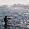 Tim Rawson casts for trout in  Nonvianuk Lake with the Walatka Mountains in the background. <br /> These photos depict a wilderness raft trip on the Alagnak Wild and Scenic River, Katmai, Alaska June 22- July 1, 2008.