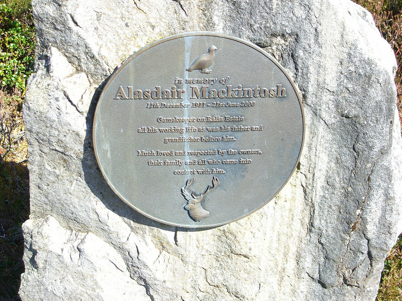 On the Military Road between Laggan and Kinguissie.   <br /> <br /> The memorial reads:<br />     In memory of Alasdair Mackintosh<br />     11th December 1911 - 21st June 2000<br /> <br />    Gamekeeper on Ralia Estate<br />    all his working life as was his father and<br />    grandfather before him.<br /> <br />    Much loved and respected by the owners, <br />    their family and all who came into<br />    contact with him.