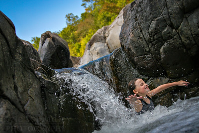 A girl crashes down in the waters of Johnsons' Shut-ins State Park.  Photo by Kyle Spradley | www.kspradleyphoto.com