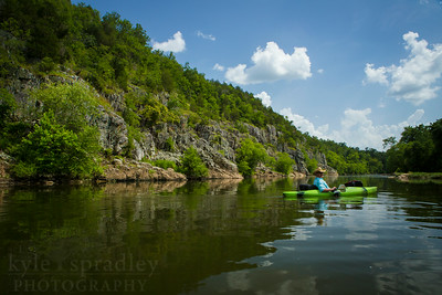 Float along the St. Francis River in Madison County, Missouri in summer. This lesser-known stretch of the famed river is loaded with boulders and scenic bluffs. Lee's Bluff and the Fish Hatchery and two prominent points along the way. The caverns at Marsh Creek also are a scenic geologic feature along the river.  Photo by Kyle Spradley | © Kyle Spradley Photography | www.kspradleyphoto.com
