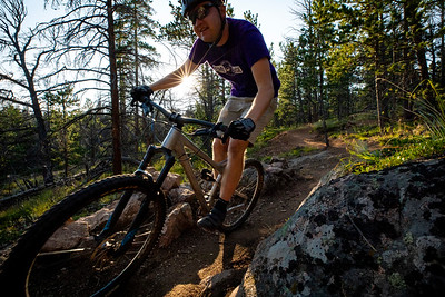 John Westenhoff and Travis Kolbo mountain bike at the Happy Jack Recreation Area in the Medicine Bow-Routt National Forest outside of Laramie, Wyoming. The popular trail recently has been fixed up to be more sustainable and thrilling for mountain bikers.   Photo by Kyle Spradley | www.kspradleyphoto.com