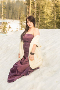 Image of woman in dress surrounded by snow