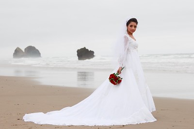 Bride holding flowers on Oregon Coast