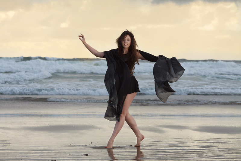 Image of girl dancing on the beach